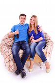 Young People Sitting On A Sofa And Drinking Coca Cola