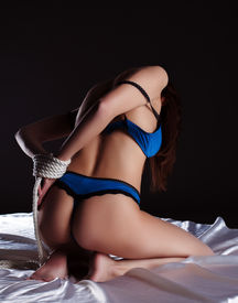 stock photo of nu  - Rear view of seductive slim woman with tied hands - JPG