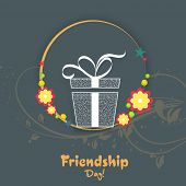Stylish gift box on floral decorated circle for Happy Friendship Day celebrations.
