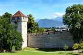 LUCERN, SWITZERLAND - JULY 3, 2014: The Musegg Wall and Schirmer Tower, Lucern. With nine guard towe