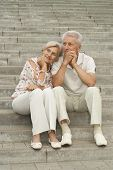 Attractive elderly couple went for a walk