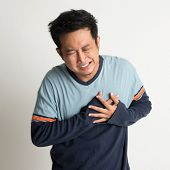 stock photo of breast-stroke  - Asian male heartache - JPG
