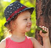 Fun Happy Eating Cucumber And Smiling On Park Green Background. Closeup Portrait