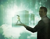 Businessman jumping holding an umbrella held by giant businessman against data servers resting on cl