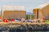 PUNO, PERU, MAY 5, 2014 - Inhabitants of Uros islands on Titicaca lake gather together for some rest