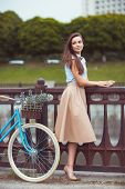 Young Beautiful, Elegantly Dressed Woman With Bicycle, Summer And Lifestyle