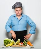 picture of fanny  - Fanny plump cook on gray wall background - JPG