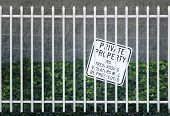 Security Iron Fence And No Tresspassing Sign