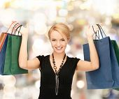 shopping and retail concept - lovely woman with shopping bags