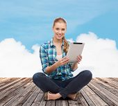 happiness, technology, internet and people concept - smiling young woman in casual clothes sitting o