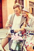 summer holidays, bikes, love, relationship, navigation, gps and dating concept - couple with bicycle
