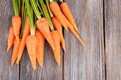 Fresh carrot on wooden background