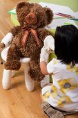 Girl Having Fun With Teddy Bear