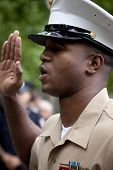 NEW YORK - MAY 23, 2014: A close up of U.S. Marine Brandon King as he raises his hand while taking the Oath to re-enlist during the ceremony at the National September 11 Memorial site.