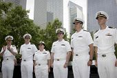 NEW YORK - MAY 23, 2014: Rear Admiral Scott A. Stearney applauds the naval officers promoted during