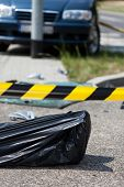 image of corpses  - Corpse in bag after car accident vertical - JPG