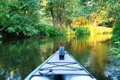 picture of kayak  - kayak on a small river - JPG