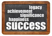 success components - happiness, significance, achievement, legacy on a  vintage blackboard