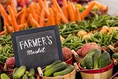 stock photo of farmers  - Fresh organic produce on sale at the local farmers market.