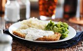 picture of southern fried chicken  - country fried steak with southern style peppered milk gravy shot in panorama style - JPG