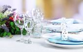 Dining table setting with lavender flowers on table, on bright background. Lavender wedding concept
