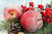 Christmas composition with red winter apples on table close up