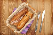 Homemade french bread over wooden table background