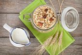 Healty breakfast with muesli and milk. View from above on wooden table