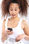 Surprise - dark skinned girl reads sms