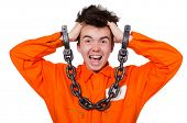 stock photo of inmate  - Young inmate with chains isolated on the white - JPG