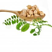 Chick peas over wooden spoon  isolated on white background