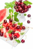 Fresh Fruits Salad Of Melon, Watermelon And Cherries  Decorated With Mint