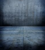Dark and dim concrete wall and floor.
