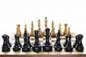 foto of chessboard  - Black and white chess pieces on a chessboard isolated over white - JPG