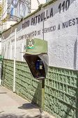 LA PAZ, BOLIVIA, MAY 8, 2014 - Public phone decorated with a copy of military cap