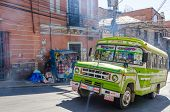 LA PAZ, BOLIVIA, MAY 8, 2014 - Colorful bus transports local people in La Paz center