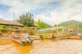 RURRENABAQUE, BOLIVIA, MAY 11, 2014 - Traditional wooden boats moor on Beni river bank