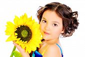 Beautiful smiling girl in bright summer dress holds a sunflower. Isolated over white.