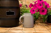 Still Life Of A Small Beer Barrel With Some Flowers