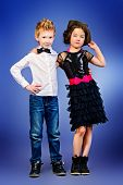 Full length portrait of two modern kids posing together. Fashion shot.