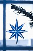 Closeup of blue star shape Christmas ornament