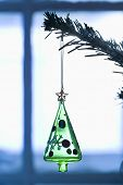 Closeup of Christmas decoration hanging on branch