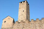 BELLINZONA, SWITZERLAND - JULY 4, 2014: Torre Bianca (White Tower) and ramparts at Castelgrande, Bellinzona. Castelgrande is a UNESCO World Heritage Site since 1983.