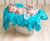 lovely newborn baby sleeps in a wicker basket