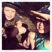 Two girls having fun together geocaching - With Instagram effect