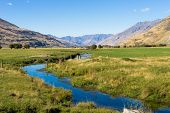 Natural landscape of New Zealand alps and stream