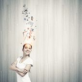 Young smiling woman with colorful thoughts above head