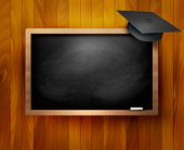 Blackboard with  graduation cap.