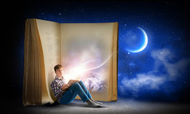 picture of boys night out  - Teenager boy wearing jeans and shirt and reading book - JPG