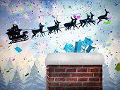 Santa flying his sleigh behind chimney against twinkling stars
